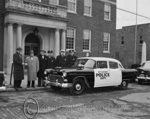 Police Chief Patrick O'Brien with cruiser, c.1952. Photograph, courtesy of the Greater Pittston HIstorical Society.