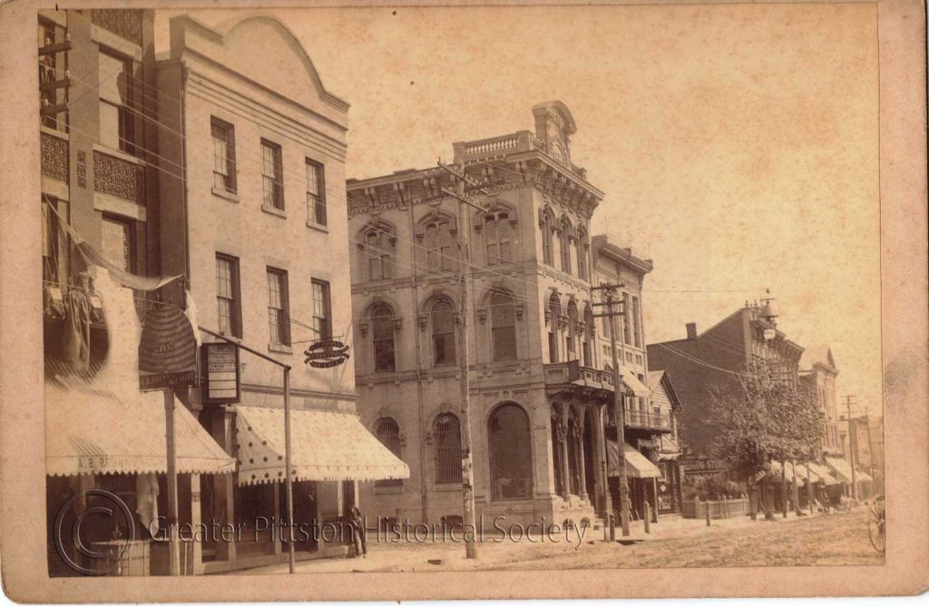 """North Main & William Street, showing A. B. Brown's """"Bee Hive"""" (c.1900). Photograph, courtesy of the Greater Pittston HIstorical Society."""